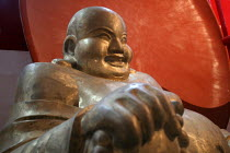 17-10-2003 - Carved wooden Laughing Buddha for sale. Tiantai Buddhist City, Tiantai, Zhejiang Province, China. © Jess Hurd
