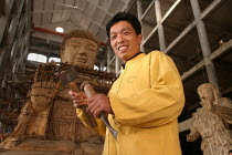17-10-2003 - Work on the largest wooden Buddha in the world destined for a Buddhist Temple in Los Angeles, California, USA. Tiantai Buddhist City, Tiantai, Zhejiang Province, China. © Jess Hurd