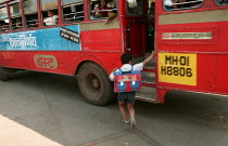 23-01-2004 - Child boards a bus on his way to school, Jogeswari, Mumbai, India. © Jess Hurd