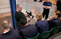 22-06-2004 - Police officer demonstrates the use of a Baton Round gun at a Prime Training Solutions, Public Safety Awareness Course for journalists. Greater Manchester Police training facility, Claytonbrook Comple... © Jess Hurd