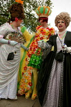 03-07-2004 - Drag Queens admire each others outfits at the London Gay Pride march. © Jess Hurd