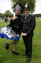 03-07-2004 - Gay MET police officer with drag queen at Gay Pride London. Trafalgar Square. © Jess Hurd