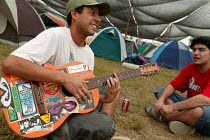 24-01-2005 - World Social Forum, Porto Alegre Brazil. Delegate sing rebel songs with a guitar in the youth camp. © Jess Hurd