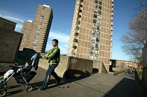 18-03-2005 - Father with child in a push chair on the 1970's Crossways Estate which is due for demolition. Tower Hamlets, East London © Jess Hurd