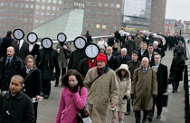 23-02-2006 - Work Your Proper Hours Day organised by the TUC. People with clock faces mingle with commuters on London Bridge. © Jess Hurd