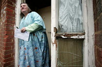 20-04-2006 - Marilyn Boyle who has been waiting for council repairs for twenty years. She has heart problems, her husband has emphysema and they live in a house riddled with woodworm which has rotted the flooring... © Jess Hurd