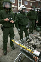 02-06-2007 - Police with a Netto shopping trolley full of stones. Protests at the G8 summit in Heiligendamm, Rostock, Germany. © Jess Hurd