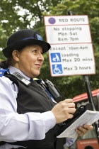 24-08-2007 - PCSO, Police Community Support Officer on traffic duty in Westminster, London. © Jess Hurd