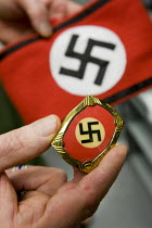 19-06-2008 - Alabama, USA, Nazi memorabilia, badge an original from the Hitler Youth. The USA has seen a dramatic increase in white supremacist organisations and racist attacks against immigrants in the last few y... © Jess Hurd