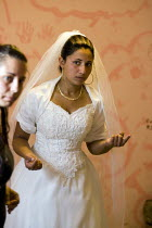 27-07-2008 - Roma Gypsy wedding in Rome where the bride is traditionally dressed by two virgins. Italy. © Jess Hurd