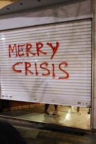 24-12-2008 - Merry Crisis graffiti. Demonstration called after the fatal shooting by the police on Dec. 6 of a 15-year-old, Alexandros Grigorolopoulos. Athens, Greece © Jess Hurd