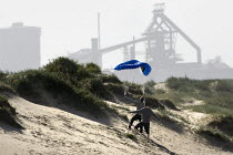12-05-2009 - Children flying a kite. The Corus Redcar steelworks at Redcar Co Cleveland which is to be mothballed with the loss of over 2000 jobs after parent company Tata announced the cancellation of 4 major con... © Jess Hurd