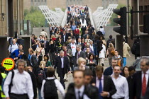 10-06-2009 - Commuters walk over the Millennium Bridge to get to work during the RMT tube strike. London. © Jess Hurd