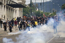 15-06-2011 - Running battles between police and protesters outside the Greek parliament as the trade unions hold a general strike against IMF imposed austerity measures. Syntagma Square, Athens, Greece. © Jess Hurd