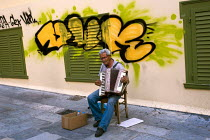 18-06-2011 - Elderly man plays the accordion for money, Plaka, Athens. Greece. © Jess Hurd