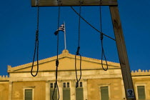 19-06-2011 - Demonstrators with a hangmans noose outside the Greek Parliament. Against austerity cuts. Syntagma Square, Athens, Greece. © Jess Hurd