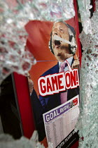 08-08-2011 - Smashed shopwindow of a betting shop. Riots spread to Hackney following the fatal police shooting of Mark Duggan, East London. © Jess Hurd