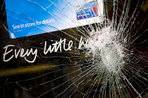 10-08-2011 - Smashed window of Tesco - Every little helps campaign slogan for the loyalty card Clubcard, suggesting low prices, following the fatal police shooting of Mark Duggan, 29, was killed by police in Totte... © Jess Hurd