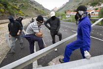 19-06-2012 - Miners win running battles with police in Cinera after they have blocked the mountain road. The miners have been on strike since the government announced cuts to mining subsidies due to austerity cuts... © Jess Hurd