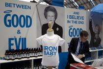 30-09-2013 - Iron Baby t shirt. Margaret Thatcher memorabilia merchandise The Maggie Collection at The Conservative Party shop. Conservative Party Conference 2013. Manchester. © Jess Hurd