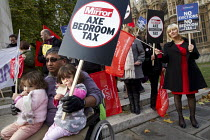 11-12-2013 - Tenants and disabled peoples groups protest outside Parliament as MP's debate abolition of the Bedroom Tax, Westminster, London. © Jess Hurd