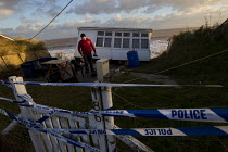 06-12-2013 - Police tape. Badly damaged cliff-top homes after Xavier, the largest tidal surge in 60 years battered the east coast of England. © Jess Hurd