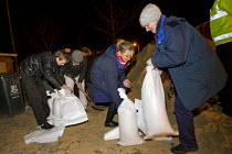 05-12-2013 - District nurses filling sand bags for vulnerable residents as storm surge Xavier hits Great Yarmouth, East Anglia. © Jess Hurd