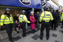 01-02-2014 - Shoppers are moved from the high street as anti fascists demonstrate in Slough against the English Defence League. © Jess Hurd