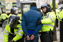 01-02-2014 - Riot police arrest a young asian boy as anti fascists demonstrate in Slough against the English Defence League. © Jess Hurd
