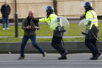 01-02-2014 - Police chase an anti fascist demonstrator in Slough against the English Defence League. © Jess Hurd