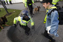 01-02-2014 - Riot police officer runs at a legal observer as anti fascists demonstrate in Slough against the English Defence League. © Jess Hurd