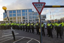 01-02-2014 - Riot police divide anti fascists from EDL. Demonstration in Slough against the English Defence League. © Jess Hurd