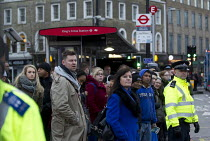 05-02-2014 - Met policing bus stops. London underground RMT and TSSA members take strike action to defend jobs and services for ticket office workers. Kings Cross. © Jess Hurd