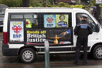 22-04-2014 - The BNP turn up at the UKIP European election campaign launch, saying that they have stolen their slogan. Sheffield. © Jess Hurd