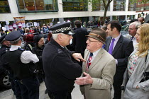 07-05-2014 - Police check UKIP tickets. Unite Against Fascism protest against UKIP London rally, Emmanuel Church, Westminster. London. © Jess Hurd