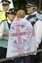 14-06-2014 - Ulster Volunteer Force - Oxfordshire flag. South East Alliance, assorted far right coalition are stopped from marching through Cricklewood by anti fascists. The Alliance were protesting about a Muslim... © Jess Hurd