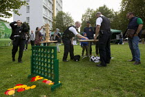 21-08-2014 - Police playing giant Jenga, Connect 4 and Carrom. Summer Night Lights, a pilot summer violence reduction programme originally launched in Los Angeles to addresses peak offending in anti social hotspot... © Jess Hurd