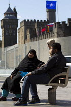 31-08-2014 - Muslim family sit outside the security fence at Cardiff Castle, a NATO Summit venue, Cardiff, South Wales. © Jess Hurd