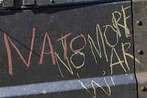 31-08-2014 - Peace protesters write anti NATO graffiti on the security fence at Cardiff Castle, a NATO Summit venue, Cardiff, South Wales. © Jess Hurd
