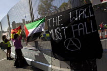 31-08-2014 - The wall must fall, reference to the Israeli aparthid wall. Peace protesters hang banners from the security fence at Cardiff Castle, a NATO Summit venue, Cardiff, South Wales. © Jess Hurd