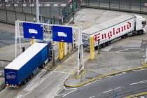 27-09-2014 - Trucks driving through fixed x-ray cargo screening system at customs, to detect stowaways and illegal goods, Eastern Docks. Port of Dover, Kent. © Jess Hurd