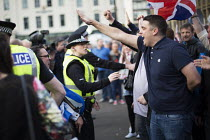 19-09-2014 - No Campaign, far right nationalists, taunt Yes Campaign with Nazi Sieg Heil salutes in George Square the day after polling day in the Scottish Independence Referendum. Glasgow, Scotland. © Jess Hurd