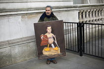 03-18-2015 - Political, satirical artist and painter Kaya Mar outside Downing Street with a new painting of a naked George Osborne for the Chancellors budget statement. London © Jess Hurd