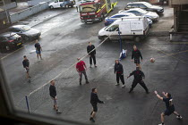 24-03-2015 - Firefighters playing beachball in the yard. Paddington Fire Station. London. © Jess Hurd