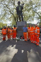 29-04-2015 - Crossrail workers show their respects. International Workers Memorial Day rally beside the Building Worker statue, Tower Hill, London. © Jess Hurd