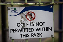 12-06-2015 - Vandalised sign - Golf Is Not Permitted Within This Park. Poplar, Tower Hamlets. East London. © Jess Hurd