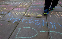 13-10-2015 - Cannabis medicinal remedies written in chalk by campaigners on the pavement outside Parliament. Westminster. London. © Jess Hurd