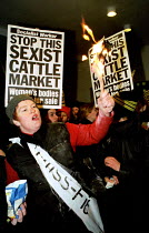 04-12-1999 - Miss World protest. Protesters carried placards and pelted people going into the Kensington Olympia with eggs and flower, burnt Barbie dolls and copies of Loaded/ FHM magazines. The demonstraters also... © Jess Hurd