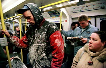 15-12-1999 - Construction worker travelling on London Tube underground transport system District Line. 6am. © Jess Hurd