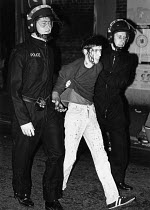 28-09-1985 - Brixton riots London 1985 Police arresting a youth with a bleeding head wound © John Sturrock